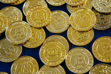 Golden bitcoins with selective focus .New virtual money.