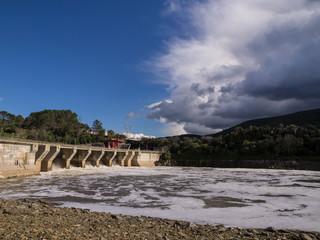 Storm on Torrejón dam open. Monfragüe National Park. Cáceres, Extremadura, Spain.