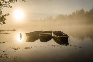 Wooden fishing boats moored on the lake shore
