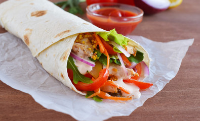 Homemade Shawarma with Chicken Meat fillet and Fresh Vegetables over Wooden Board. cooking Process.