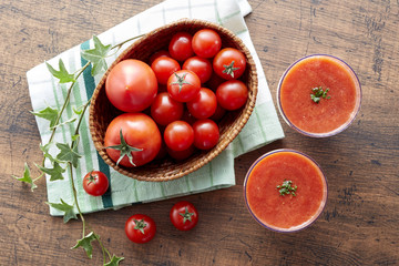 Tomato and tomato juice on a wooden table