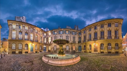 Fototapete - Panorama of Place Albertas square at dusk in Aix-en-Provence, France (static image with animated sky and water)