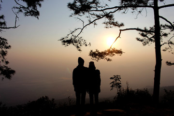Silhouette of couple man and woman at tree