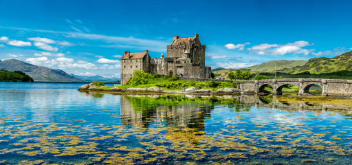 Poster Historical buildings Eilean Donan Castle during a warm summer day - Dornie, Scotland