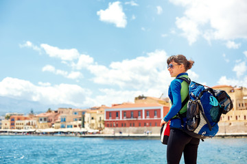 woman tourist walking on the waterfront of Chania bay backround, Crete, Greece