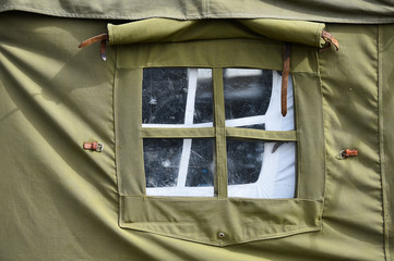 Green military tent detail shot