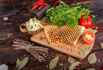 Fajitas serve with flour tortillas on rural wooden board. Food still life