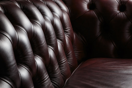 texture of the dark leather couch stitched buttons