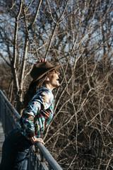 Beautiful girl having fun in the iron bridge
