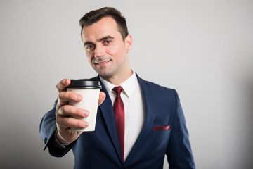 Selective focus of business man offering takeaway coffee