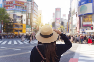 Woman is travelling at Shibuya junction in Tokyo, Japan.