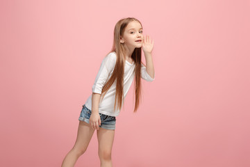 Isolated on pink young casual teen girl shouting at studio
