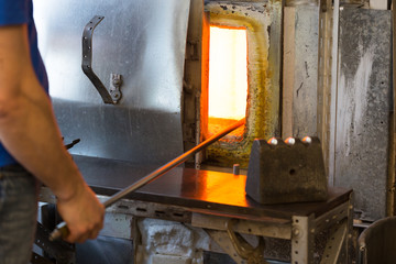 Manufacture worker heats glass in oven for heating the glass