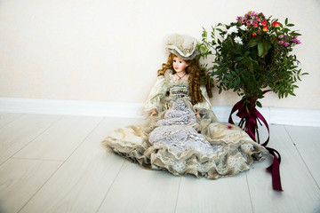 Doll and flowers on a white background.