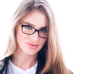 Portrait with free space. Young beautiful woman in glasses. Long flowing hair, bright white background