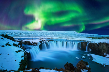 Stores photo Cascade Northern Light, Aurora borealis at Godafoss waterfall in winter Iceland.