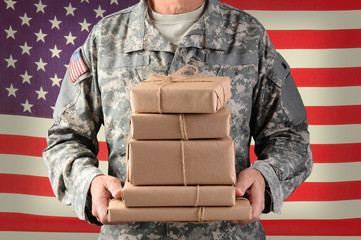 Soldier holding packages for Military Mail Call