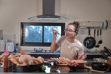 Women preparing buns at table in bakery