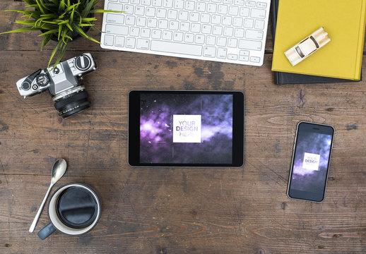 Tablet and Smartphone Mockup on Wooden Desk