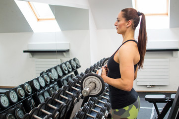 Woman with dumbbells.