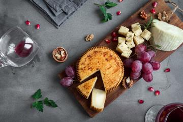 Fotobehang Assortiment Cheese, fruit platter and wine