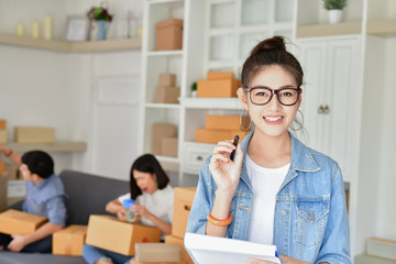 Business concept. Young Asian people are packing their packages.  Young man is working in the house. Young Owner Start up for Business Online.