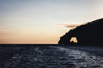 Natural arch with a sunrise