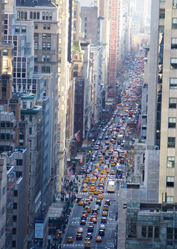 Looking down into 5th Avenue with cars in traffic in Manhattan, New York City.