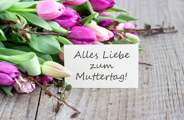 greeting card for Mother's Day / Greeting card to Mother's Day with pink and violet tulips, heart and german text: Happy Mother's Day