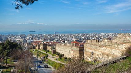 10.03.2018 Thessaloniki, Greece - Panoramic View of Thessaloniki and its Byzantine Wall Ruins, along with Thermaikos Gulf and Mount Olympus in the Background