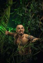 a man in the jungle with machetes attacking the enemy
