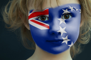 Child with a painted flag of Cook Islands