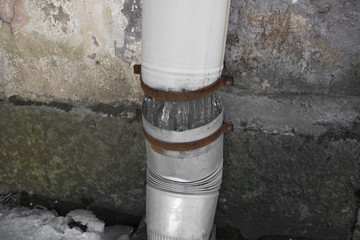 Damaged ice downpipe symbol poverty and decay