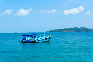 landscape view of seascape and skyline in the ocean with fishing boat and island.