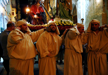 Statue bearers carrying the statue of Jesus Christ in the Garden of Gethsemane react as they reach the end of a Good Friday procession in Valletta