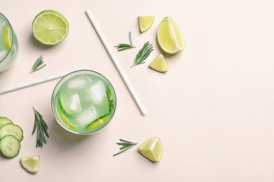 Composition with tasty lemonade on light background, top view