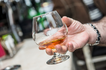 A Glass of Cognac in Man's Hand