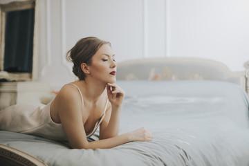 Beautiful classy woman in her bedroom