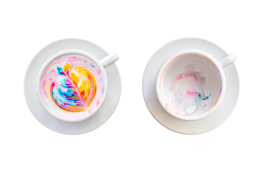 Colorful rainbow latte coffee in white cup. Isolated on white background. Saved with clipping path