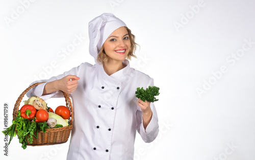 smiling happy female chef woman holds basket vegetable professional