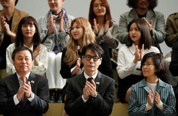Yoon Sang, the musical director for South Korean art troupe and Culture Minister Do Jong-hwan attend a ceremony before leaving for Pyongyang