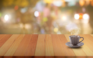 Ceramic coffee mug on a wooden board or table and abstract blurred background