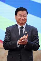 Laos' Prime Minister Thongloun Sisoulith smiles during a group photo at the Mekong Greater Sub-Region Summit in Hanoi