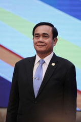 Thailand's Prime Minister Prayut Chan-o-cha smiles during a group photo at the Mekong Greater Sub-Region Summit in Hanoi