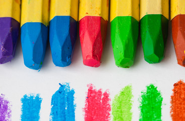 Crayons and pastels lined on white background