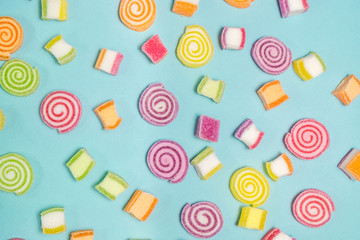 Jelly sweet candies on cyan background.