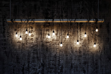 Light bulbs over dark texture background