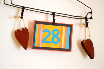Number 28 anniversary celebration card against a bright white background