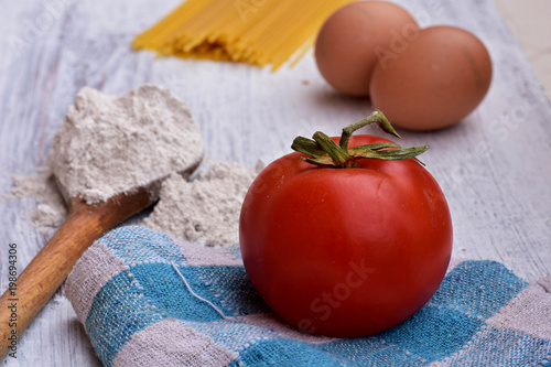 Red Tomato Eggs Pasta Spaghetti The Cooking Process Ings And Cutlery Kitchen