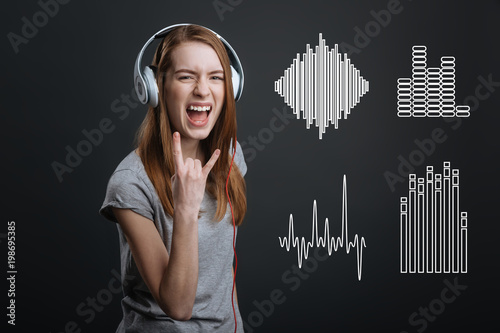 Music lover  Positive emotional teenager shouting and